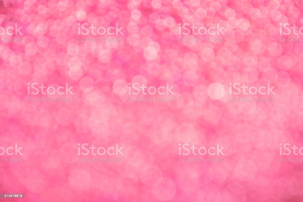 Pink festive glitter light abstract blur background royalty-free stock photo