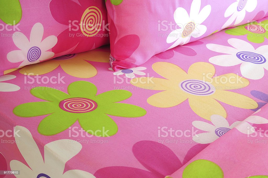 A pink floral little girls bedding set with large flowers royalty-free stock photo