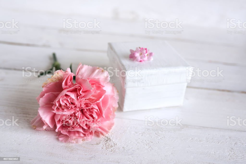 Pink flower decoration with a gift stock photo