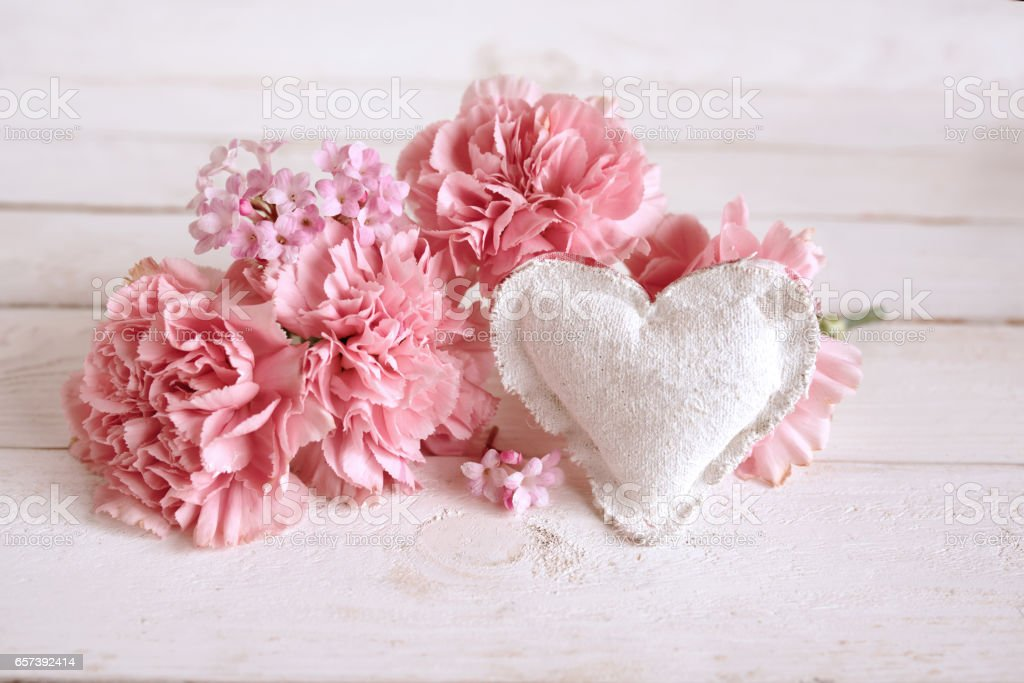 Pink flower decoration with a heart stock photo