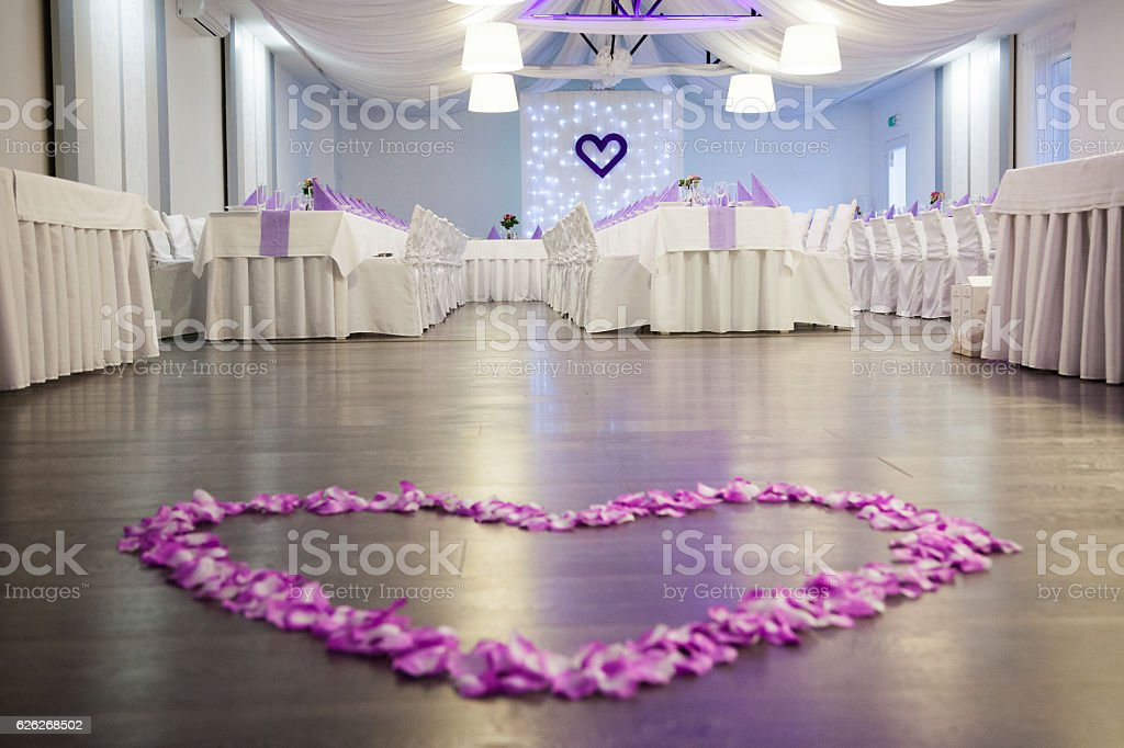 pink flower petals heart on wedding dance floor stock photo