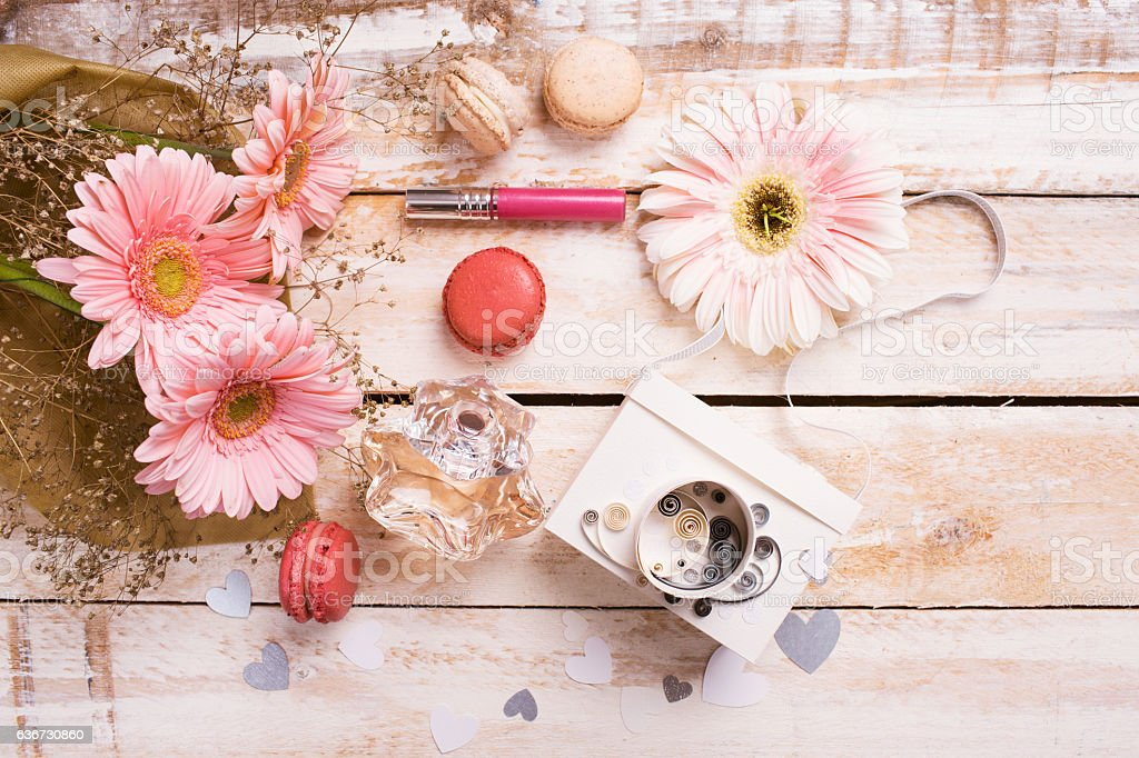 pink flowers and multi colored macarons stock photo