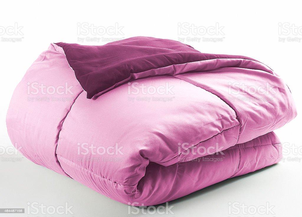 Pink folded duvet stock photo