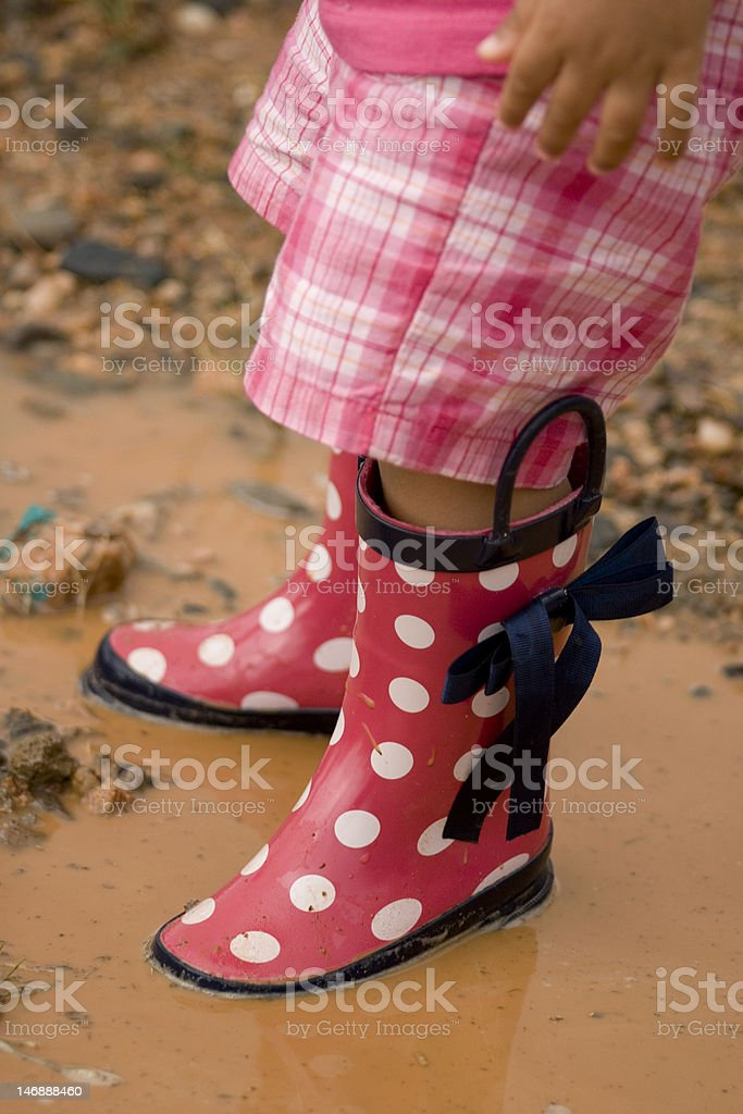 Pink Galoshes in a Puddle stock photo