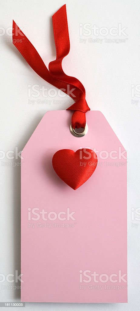 Pink gift tag and heart royalty-free stock photo