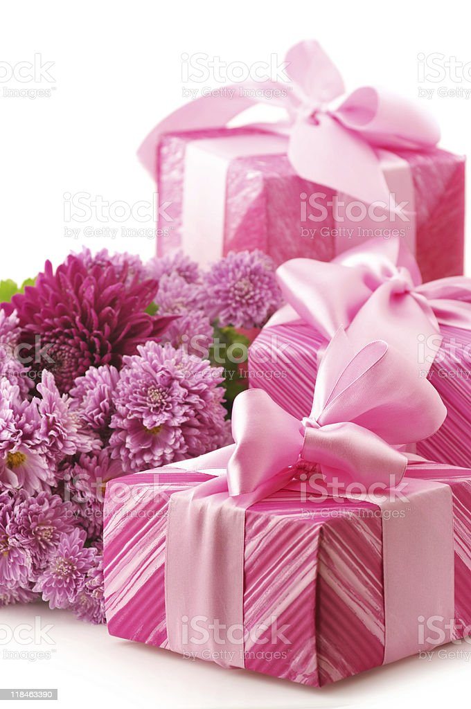 Pink gifts and chryzanthemiums royalty-free stock photo