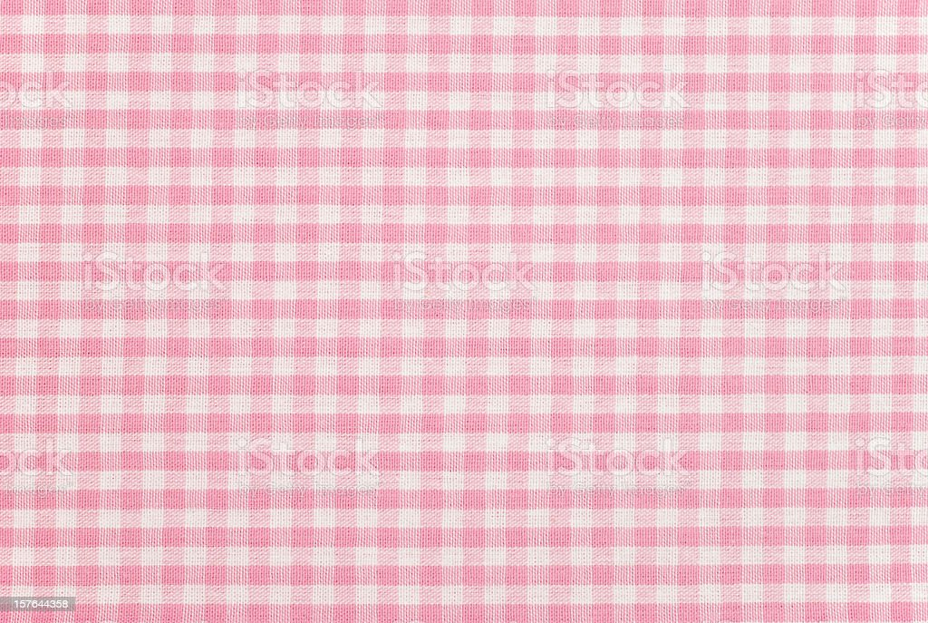 A pink gingham pattern fabric background stock photo