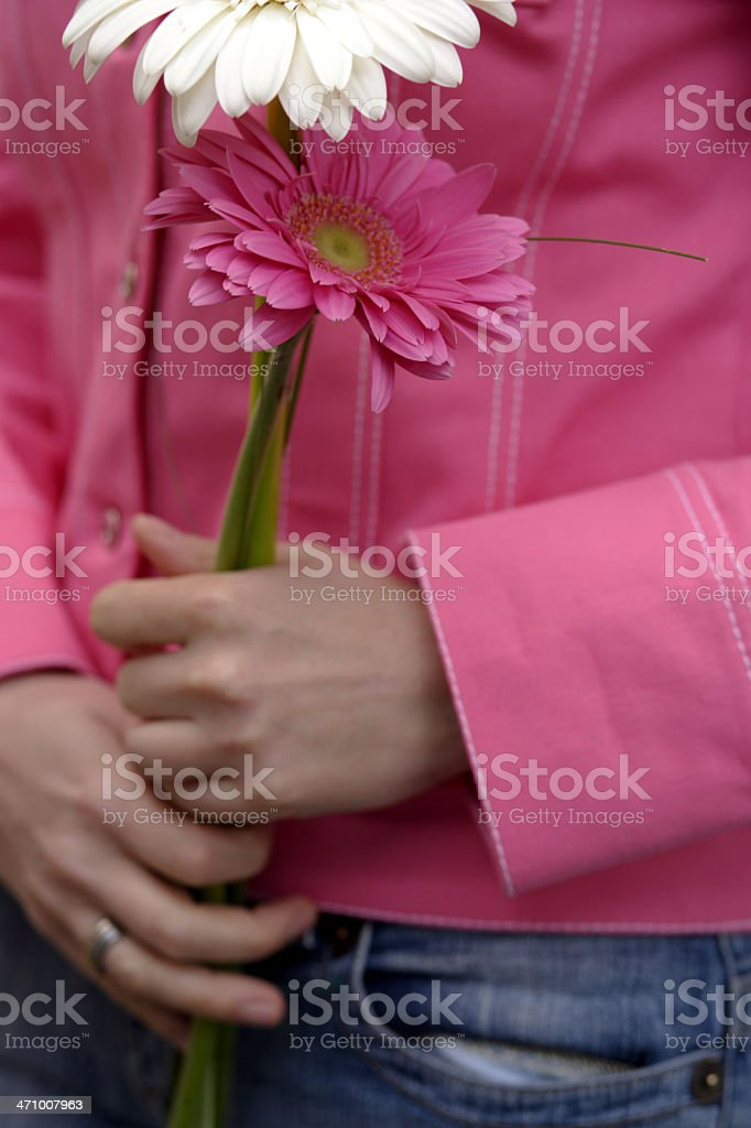 Pink girl holding flowers stock photo