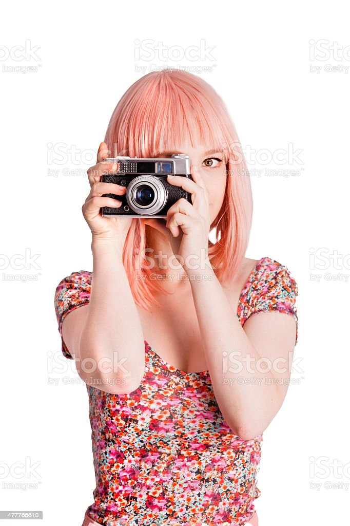 Pink girl taking a photo stock photo