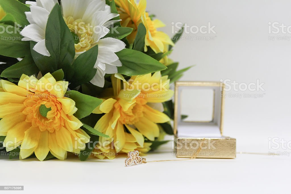 Pink Gold Necklace and sunflower bouquet stock photo