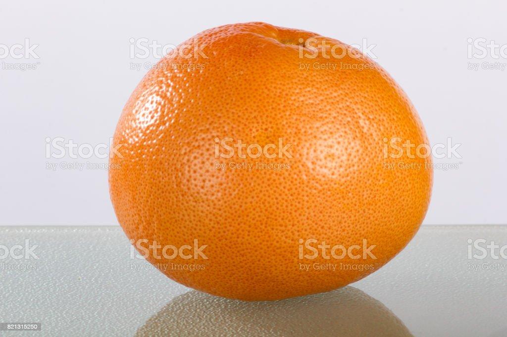 Pink Grapefruit Closeup with Reflection stock photo
