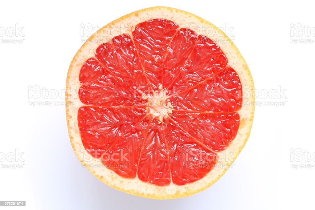 pink grapefruit slice isolated stock photo