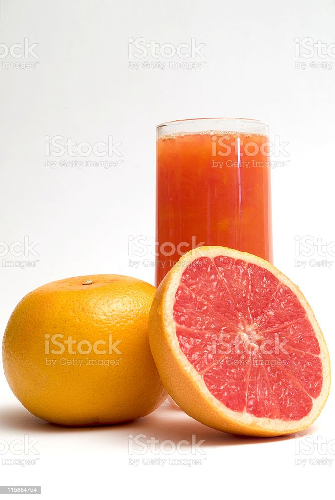 Pink grapefruits and a glass of grapefruit juice stock photo