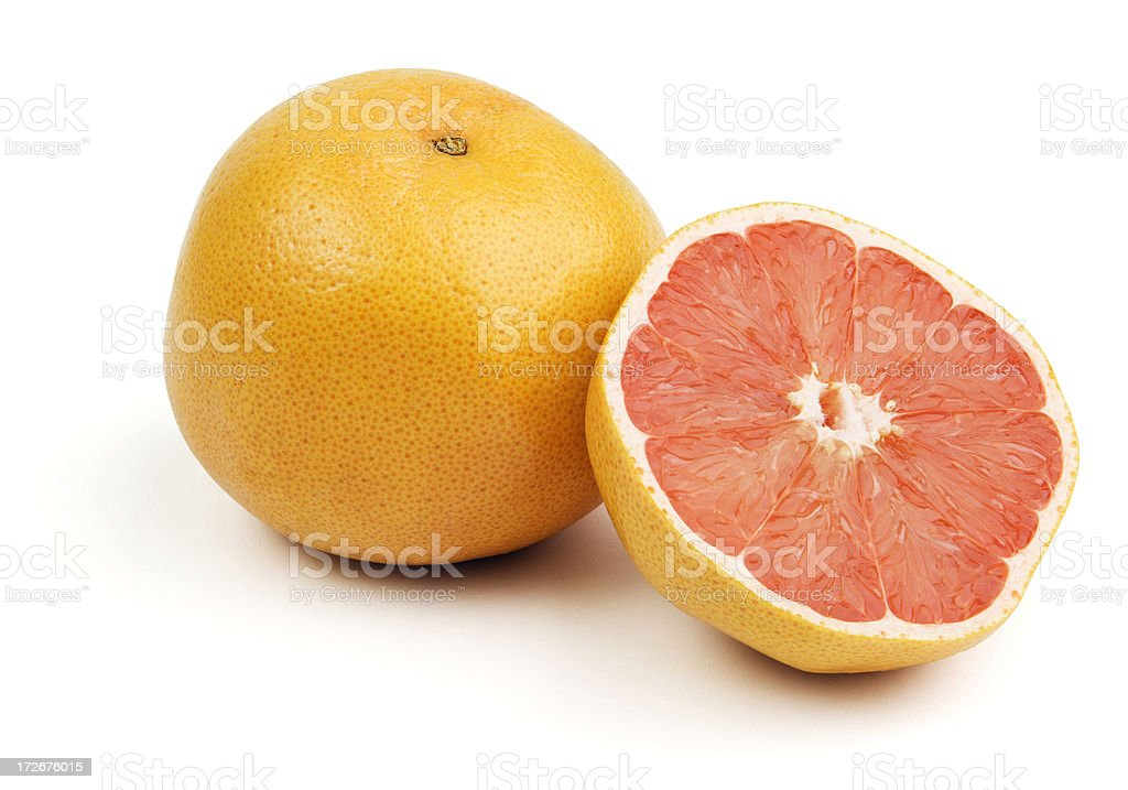 Pink Grapefruits Citrus Cut in Half Isolated on White Background stock photo