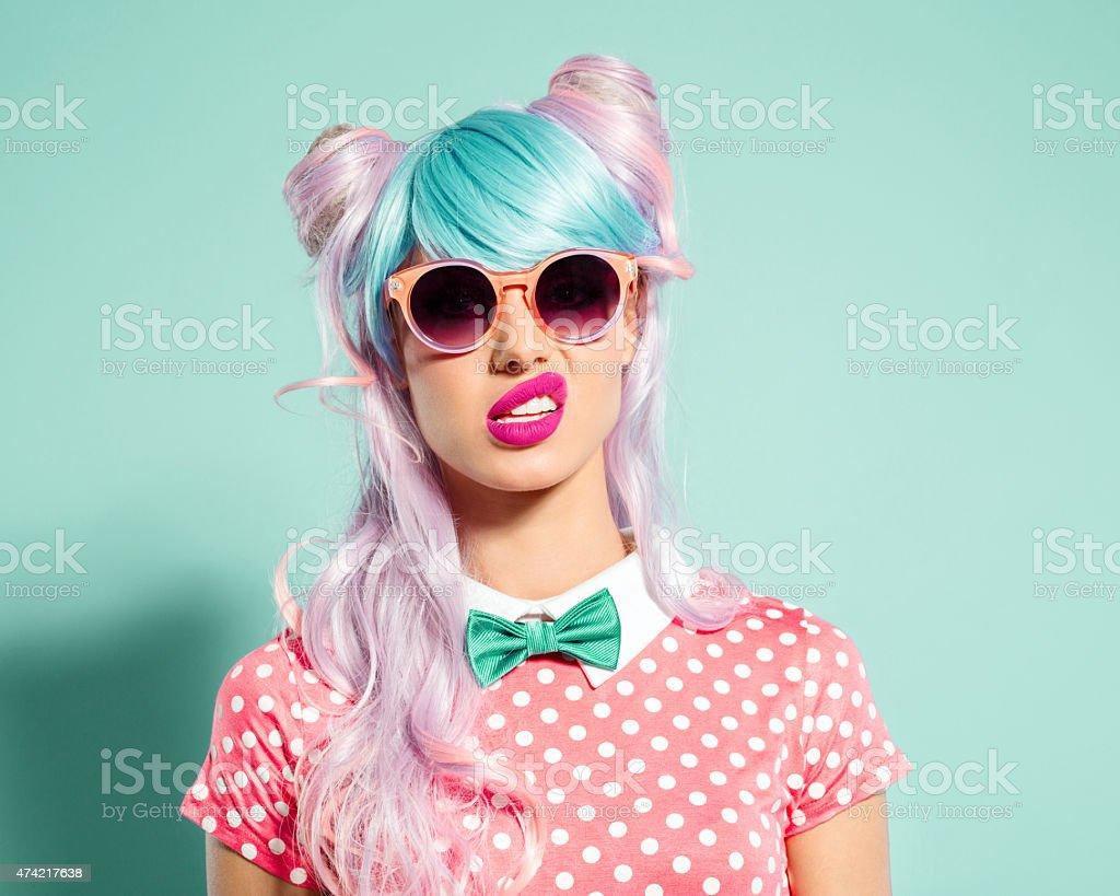 Pink hair manga style girl grimacing stock photo