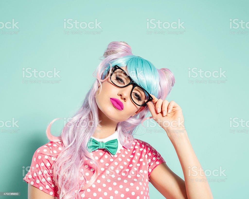 Pink hair manga style girl holding nerd glasses stock photo