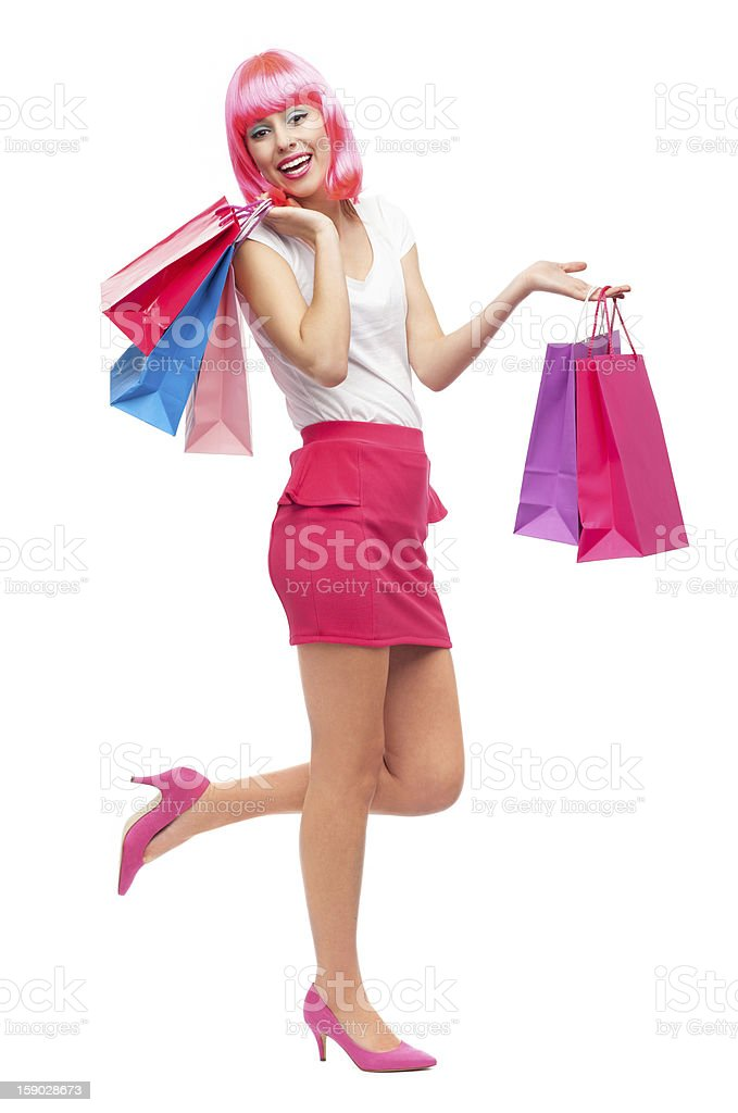 Pink hair woman holding shopping bags royalty-free stock photo
