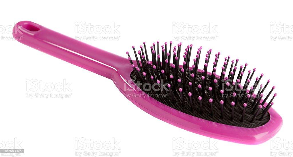 Pink hairbrush on white stock photo