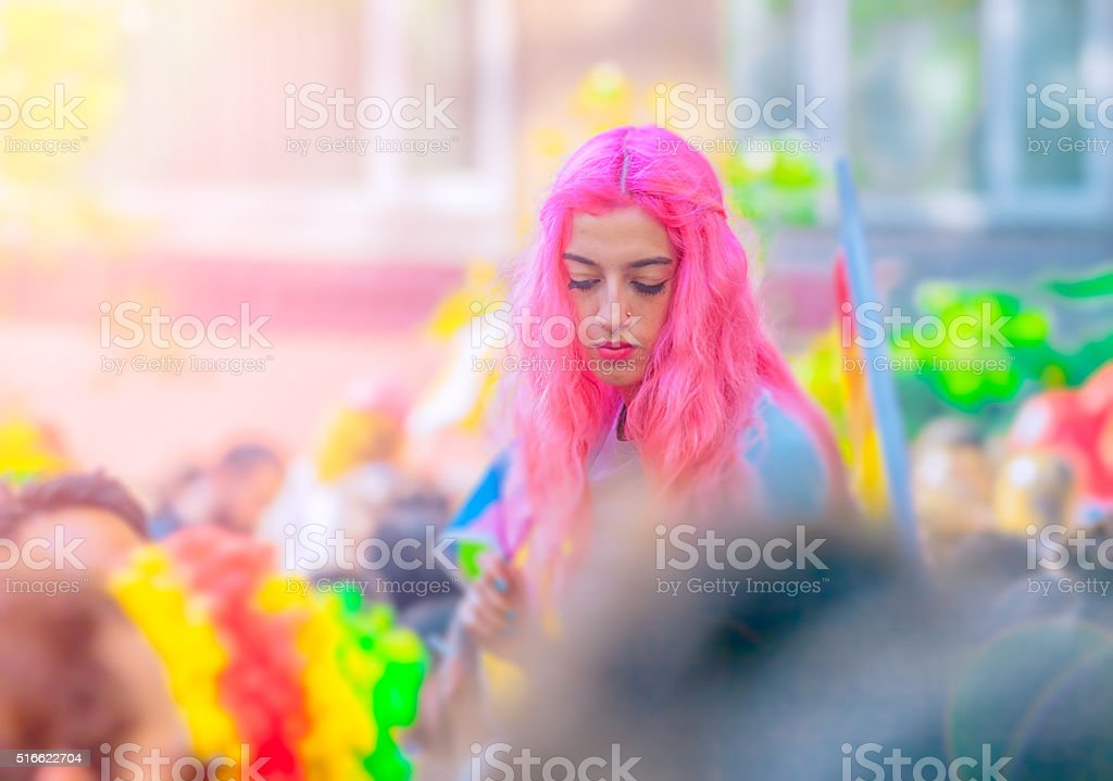 Pink haired young girl at LGBT protest stock photo