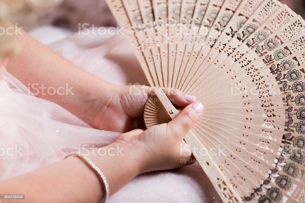 Pink hand fan stock photo