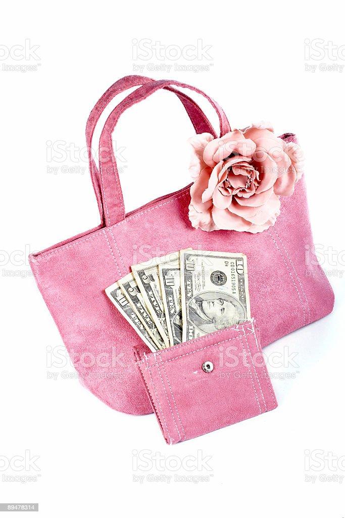 Pink handbag with money royalty-free stock photo