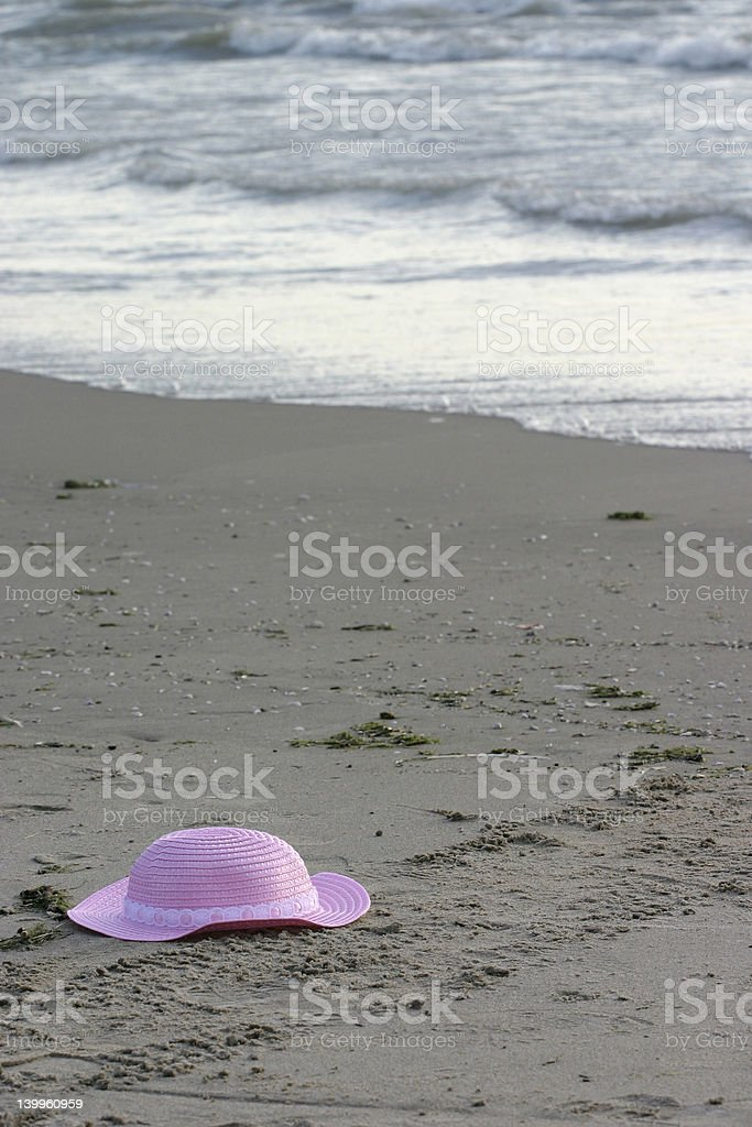 pink hat on beach royalty-free stock photo