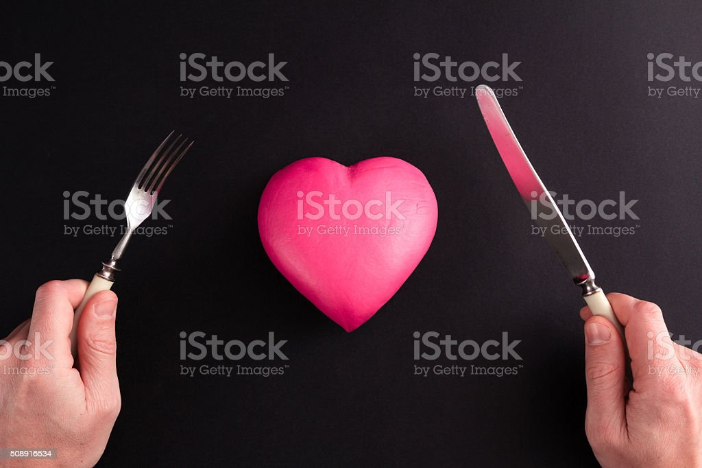 pink heart on a black background stock photo
