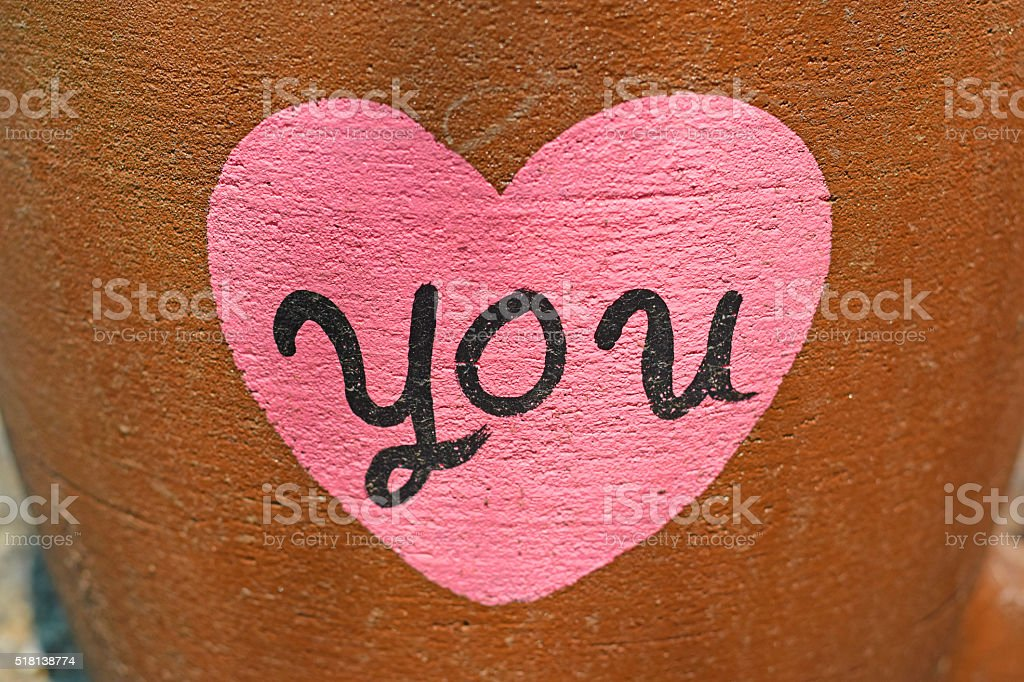Pink heart painted on wall background,Love concept stock photo