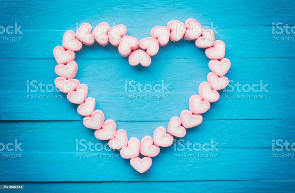 Pink heart shape marshmallow for love theme and Valentine background stock photo
