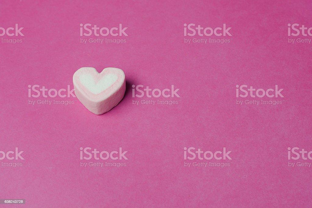 Pink heart shape marshmallows background stock photo