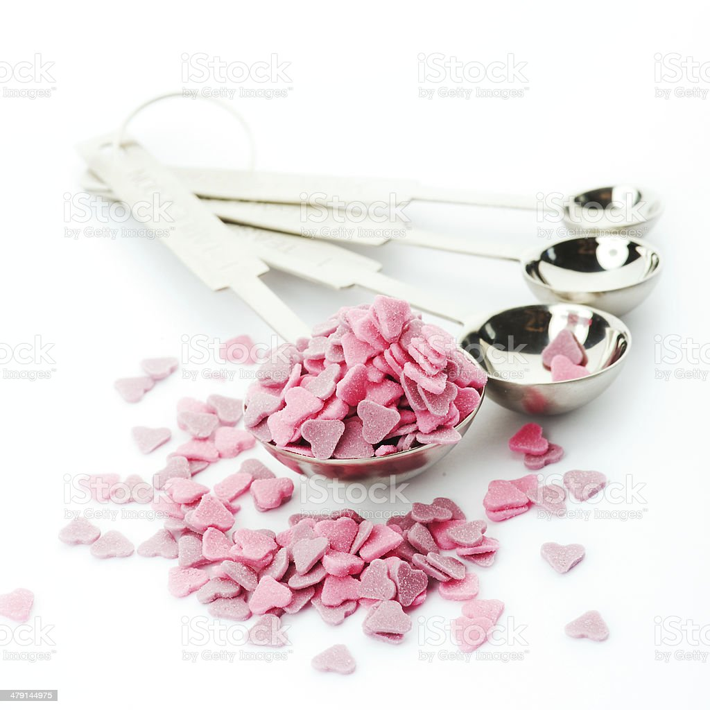 Pink heart shaped sprinkles in a measure spoon royalty-free stock photo