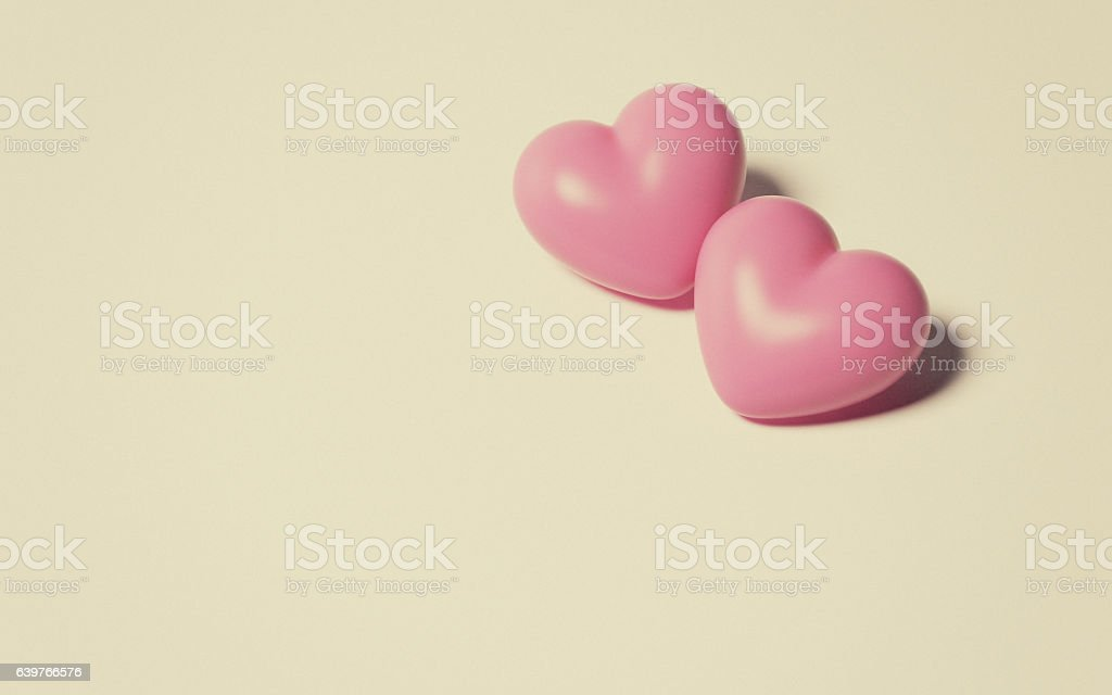 Pink Hearts on Beige Background stock photo