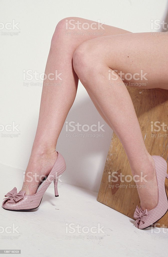 Pink heels and legs. 2 royalty-free stock photo