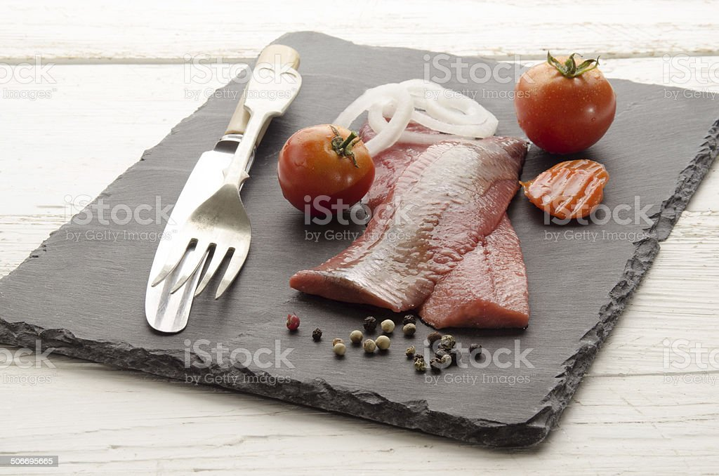 pink herring with vegetable on slate royalty-free stock photo