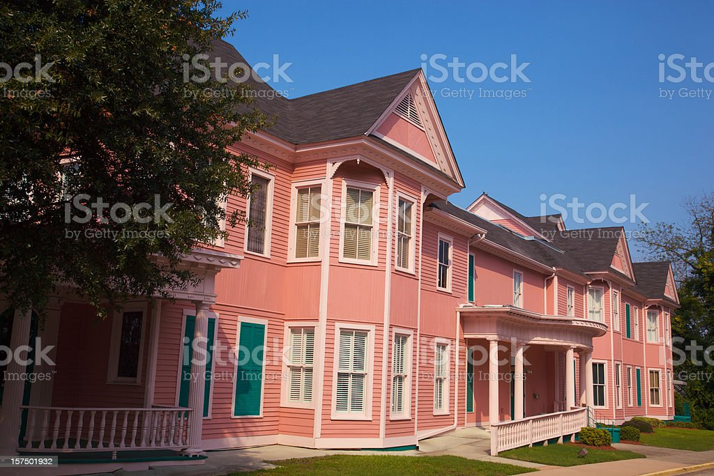 Pink Historic Office Building that Looks Like Apartments stock photo