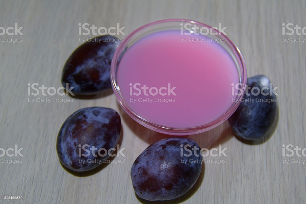 pink homemade plum soap in a glass bowl stock photo