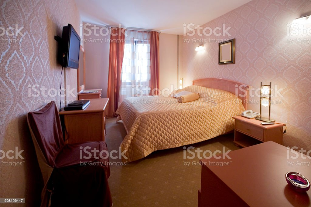 Pink hotel room interior stock photo