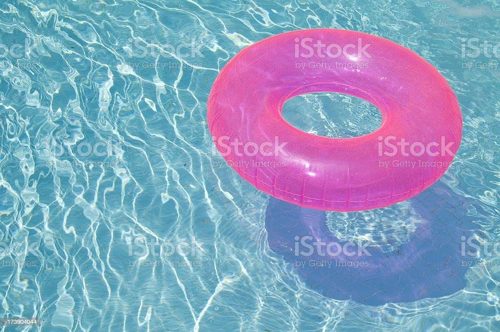 Pink Inner Tube in Swimming Pool stock photo