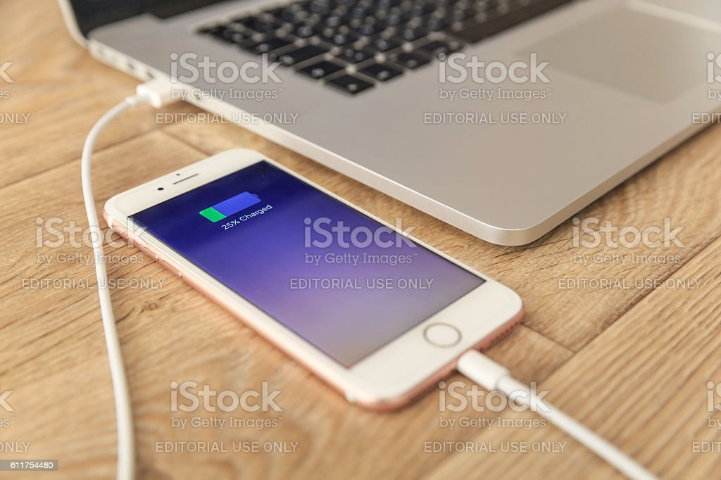 Pink iPhone 7  Home Screen with USB cable stock photo