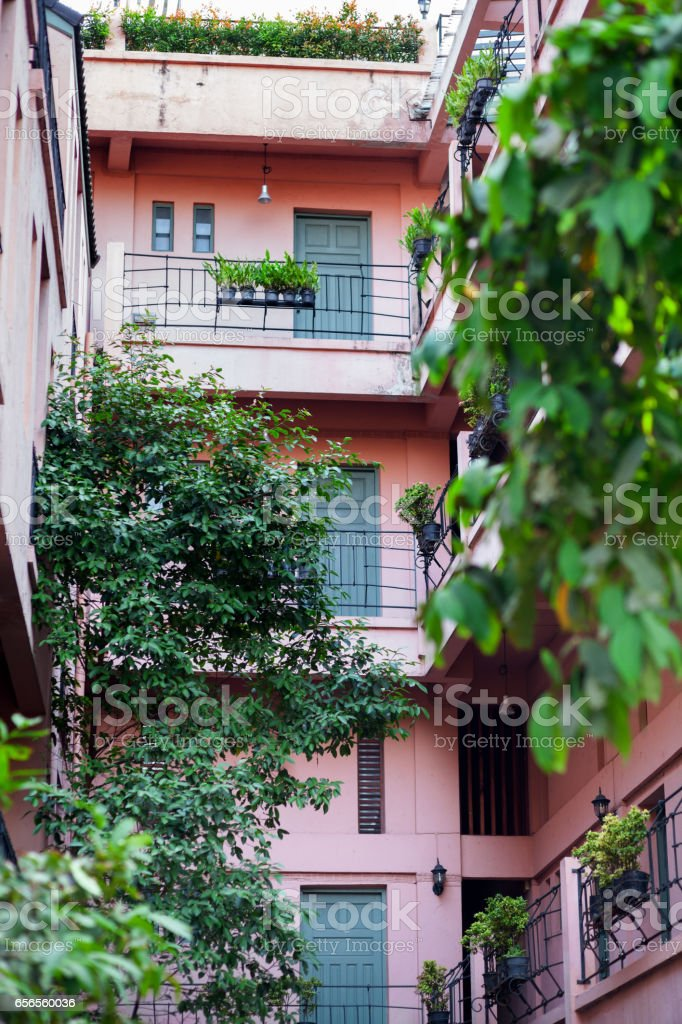 Pink italian styled condominium in Bangkok stock photo