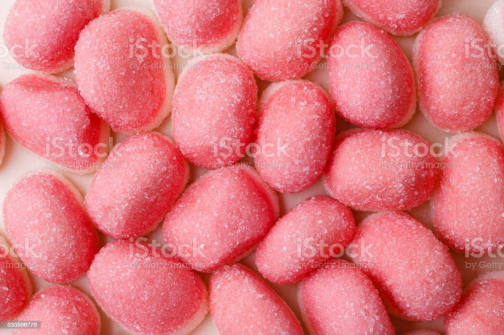 Pink jellies or marshmallows as background stock photo