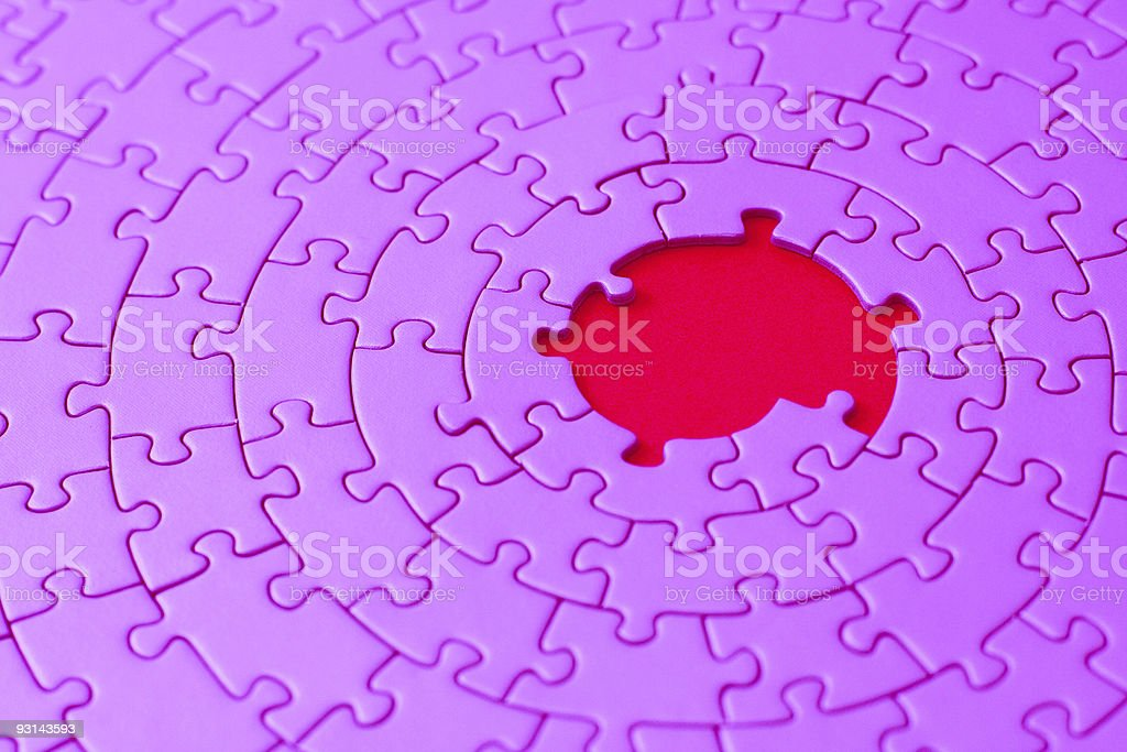 pink jigsaw with missing pieces in the center royalty-free stock photo