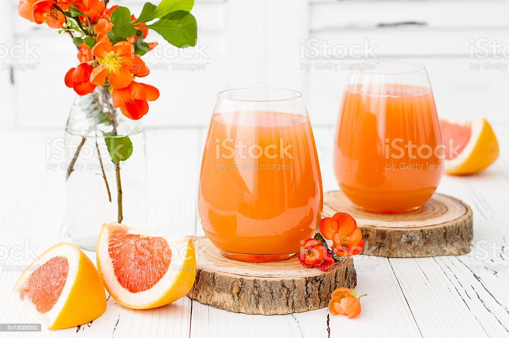 Pink juicy homemade grapefruit cocktail with alcohol stock photo