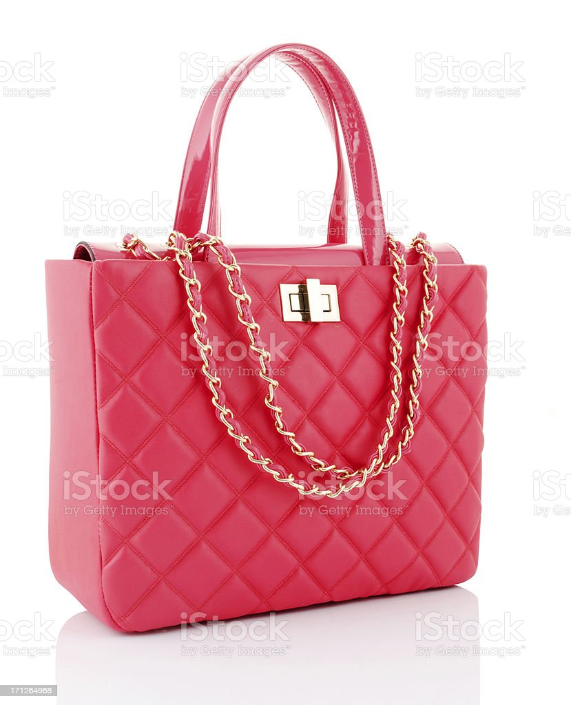 A pink leather bag with gold chains stock photo