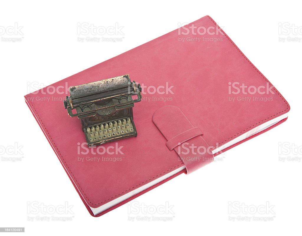 Pink Leather Diary Notebook, Typewriter and Pen Isolated on Whit royalty-free stock photo