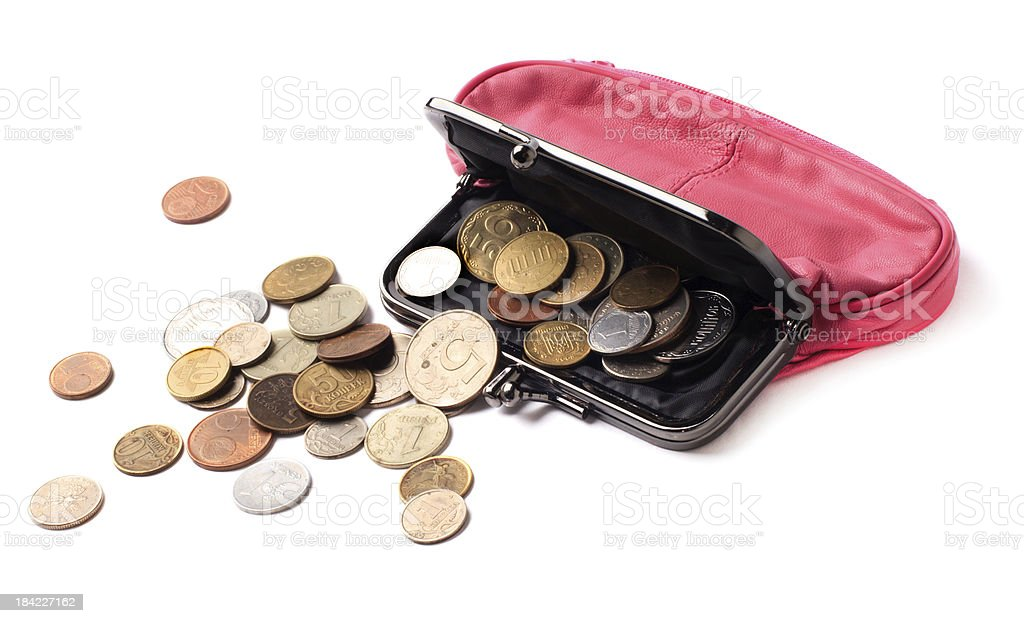 Pink leather purse and several different coins royalty-free stock photo