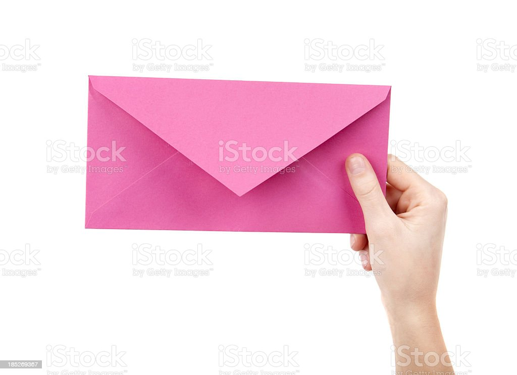 Pink letter in female hand on white stock photo