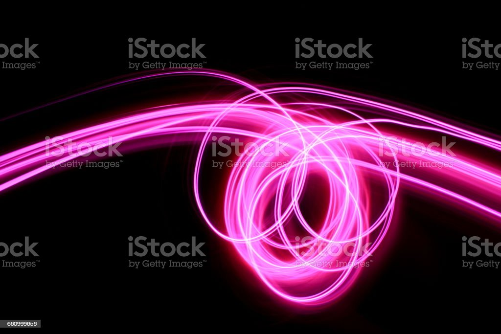Pink Light Painting Photography - swirls and loops on a clean black background stock photo