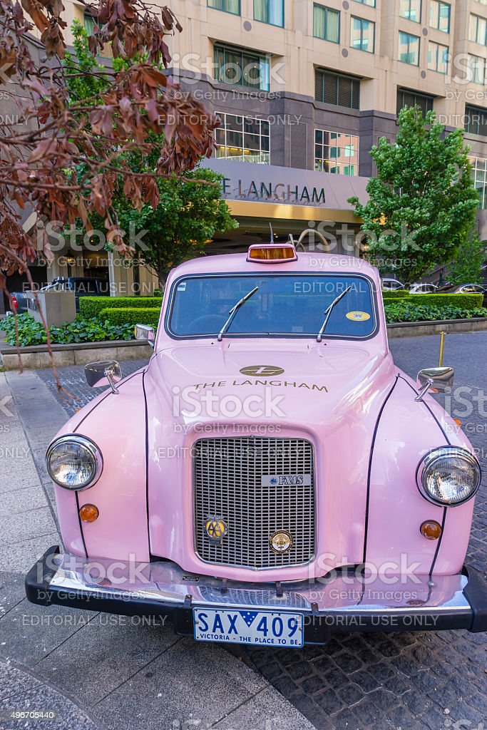Pink London Taxi of Langham Hotel stock photo
