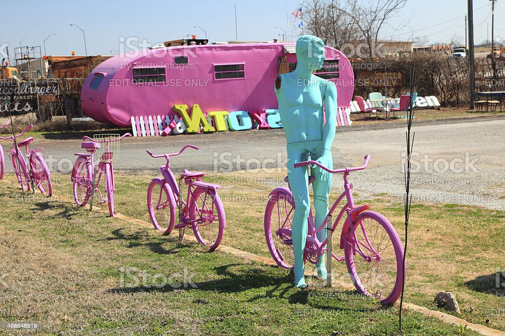 Pink Mobile Home and Bicycles with Blue Mannequin royalty-free stock photo